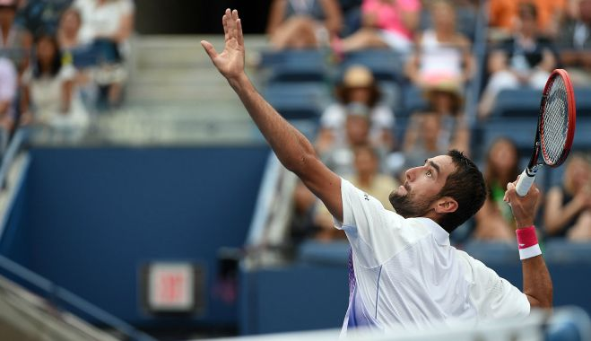 September 8, 2015 - Marin Cilic in action against Jo-Wilfried Tsonga in a men's singles quarterfinal match during the 2015 US Open at the USTA Billie Jean King National Tennis Center in Flushing, NY. (USTA/Andrew Ong)