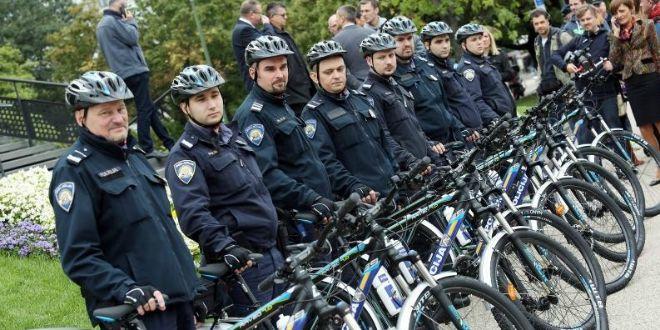 policajci, bicikli